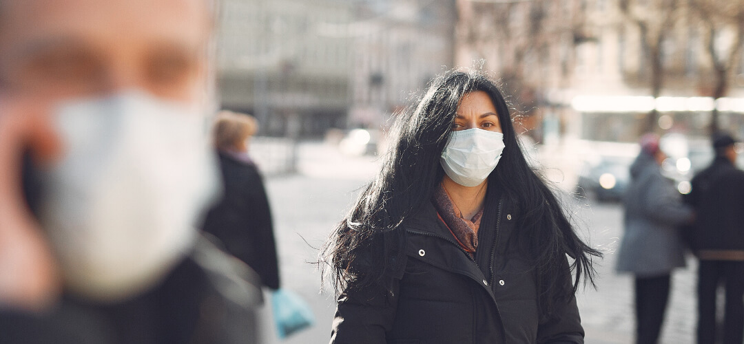 pedestrians walking to marketing agency with masks to protect them